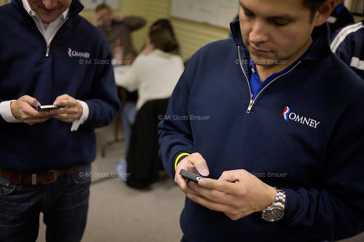 Volunteers use cell phones to gather support for Mitt Romney at the Romney New Hampshire campaign headquarters in Manchester, New Hampshire, on Jan. 7, 2012. Romney is seeking the 2012 Republican presidential nomination.