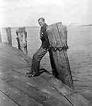 Lakewood NY:  Brady Stewart waiting for the City of Cleveland Ferry. Photographs taken during a church field trip to Chautauqua Institution in New York (Lake Chautauqua). The Stewart family and friends visited Chautauqua during 1901 to hear Stewart relative, Dr. S.H. Clark  speak at the institute. Alice Brady Stewart chaperoned and Brady Stewart came along to photograph the trip.  The Gallery provides a glimpse of how the privileged and church faithful spent summers at Lake Chautauqua at the turn of the century.