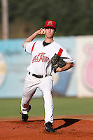 Chase Johnson #43 of the Salem-Keizer Volcanoes pitches against the Tri-City Dust Devils at Volcanoes Stadium on July 27, 2013 in Keizer, Oregon. Tri-City defeated Salem-Keizer, 5-4. (Larry Goren/Four Seam Images)