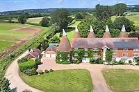 BNPS.co.uk (01202 558833)<br /> Pic: KnightFrank/BNPS<br /> <br /> Pictured: An aerial view of the house.<br /> <br /> An impressive family home built in an 'industrial scale' oast house with multiple circular rooms is on the market for £1.6m.<br /> <br /> The property is one half of a massive former six roundel oast house that has been expanded and renovated by the current owners.<br /> <br /> Estate agents Knight Frank say the roundels are far larger than normally seen in most oast houses, which means the property has quirky character while also being a practical family home.<br /> <br /> This six-bedroom house is in the picturesque Kent countryside, but just 1.5 miles from the village of Hadlow and ten minutes' drive from the bigger town of Tonbridge.