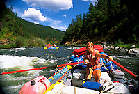 A female riverguide during a white water rafting tour on the Rogue River. Oregon.