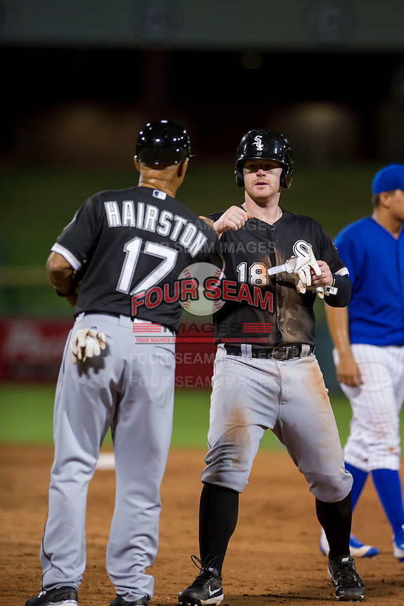 AZL White Sox left fielder Alex Destino (18) celebrates with first base coach Jerry Hairston Sr (17) after hitting a double against the AZL Cubs on August 13, 2017 at Sloan Park in Mesa, Arizona. AZL White Sox defeated the AZL Cubs 7-4. (Zachary Lucy/Four Seam Images)