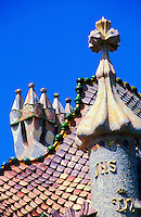 Spain. Barcelona.  Detail of chimneys, roof and tower of Casa Batllo by the architect Gaudi..