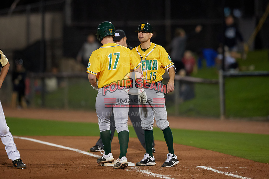 Siena Saints coach Anthony Spataro (15) and Pat O'Hare (17) during a game against the UCF Knights on February 14, 2020 at John Euliano Park in Orlando, Florida.  UCF defeated Siena 2-1.  (Mike Janes/Four Seam Images)