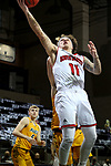 SIOUX FALLS, SD - MARCH 8: Mason Archambault #11 of the South Dakota Coyotes gets a layup against the North Dakota State Bison during the Summit League Basketball Tournament at the Sanford Pentagon in Sioux Falls, SD. (Photo by Dave Eggen/Inertia)