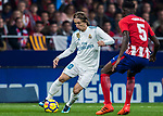 Luka Modric (c) of Real Madrid fights for the ball with Thomas Teye Partey (r) of Atletico de Madrid during the La Liga 2017-18 match between Atletico de Madrid and Real Madrid at Wanda Metropolitano  on November 18 2017 in Madrid, Spain. Photo by Diego Gonzalez / Power Sport Images