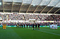 Members of the armed forces join match officials and players to observe a minute's silence during the Premier League match between Swansea City and Brighton and Hove Albion at The Liberty Stadium, Swansea, Wales, UK. Saturday 04 November 2017