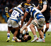 Photo: Richard Lane/Richard Lane Photography. London Wasps v Bath Rugby. Amlin Challenge Cup Semi Final. 27/04/2014. Wasps' Charlie Hayter is dump tackled by Bath's Kyle Eastmond and Leroy Houston.