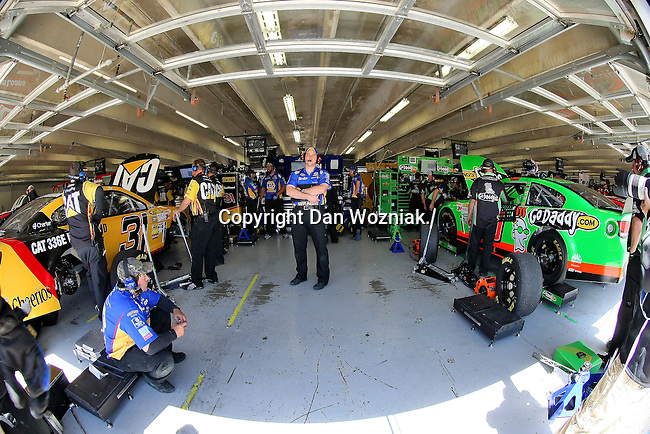 Sprint Cup Series driver Martin Truex Jr. (56) team memebers get ready for him to come into the garage during the Nascar Sprint Cup Series practice session at Texas Motor Speedway in Fort Worth,Texas.