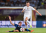 (R) Denis Cheryshev of Real Madrid CF competes for the ball with (L) Mateo Kovacic of FC Internazionale Milano during the FC Internazionale Milano vs Real Madrid  as part of the International Champions Cup 2015 at the Tianhe Sports Centre on 27 July 2015 in Guangzhou, China. Photo by Hendrik Frank / Power Sport Images