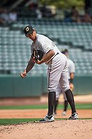 Omaha Storm Chasers starting pitcher J.C Sulbaran (32) looks to first base against the Salt Lake Bees in Pacific Coast League action at Smith's Ballpark on August 16, 2015 in Salt Lake City, Utah. Omaha defeated Salt Lake 11-4. (Stephen Smith/Four Seam Images)