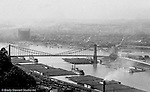 Pittsburgh PA - View of the Point Bridge and coal barges lined up on the south side of the Monongahela River - taken from Mount Washington.