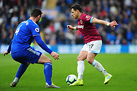 Sean Morrison of Cardiff City vies for possession with Javier Hernández of West Ham United during the Premier League match between Cardiff City and West Ham United at Cardiff City Stadium in Cardiff, Wales, UK. Saturday 09 March 2019