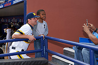 Michigan Wolverines head coach Erik Bakich (23) poses for a photo with a young fan before the first game of a doubleheader against the Canisius College Golden Griffins on June 20, 2016 at Tradition Field in St. Lucie, Florida.  Michigan defeated Canisius 6-2.  (Mike Janes/Four Seam Images)