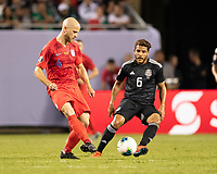 CHICAGO, IL - JULY 7: Michael Bradley #4 passes by Jonathan Dos Santos #6 during a game between Mexico and USMNT at Soldiers Field on July 7, 2019 in Chicago, Illinois.