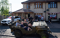 Children in a WW2 Jeep at a street  party in Welling, Kent, England 8th May 2020. Victory in Europe (VE) 75th Anniversary Celebrations during the UK Lockdown due to the Coronavirus pandemic. Photo by Alan Stanford / PRiME Media Images