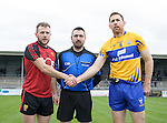 Darren O Hagen of  Down and Gary Brennan of Clare with referee Noel Mooney before their Division 2, Round 2 National League game at Cusack Park. Photograph by John Kelly.