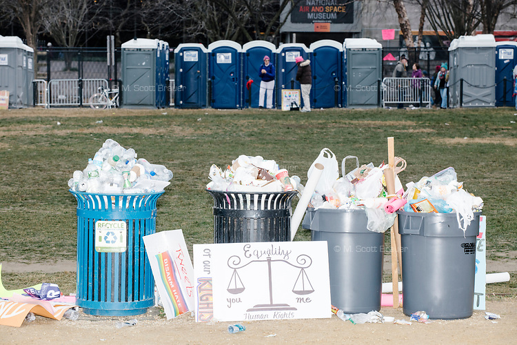Protest signs stand next to a garbage can after people gathered in the National Mall area of Washington, DC, for the Women's March on Washington protest and demonstration in opposition to newly inaugurated President Donald Trump on Jan. 21, 2017.