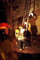 Firefighter trainees practice their skills with ladders.