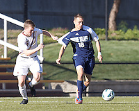 University of Rhode Island (URI) midfielder Mike Casey (18) brings the ball forward as Boston College midfielder Jason Abbott (6) defends. Boston College defeated University of Rhode Island, 4-2, at Newton Campus Field, September 25, 2012.