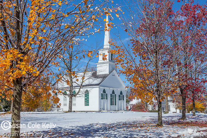 Early snow on fall foliage at the 1794 Meeting House in New Salem, MA, USA