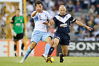 MELBOURNE, AUSTRALIA - FEBRUARY 18, 2010: Kevin Muscat from Melbourne Victory fights for the ball in the first leg of the A-League Major Semi Final match between the Melbourne Victory and Sydney FC at Etihad Stadium on February 18, 2010 in Melbourne, Australia. Photo Sydney Low www.syd-low.com