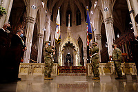 NEW YORK, NEW YORK - MARCH 17: Military members wait in St. Patrick Cathedral before a mass during St. Patrick's Day on March 17, 2021 in New York. St. Patrick's Day Parade organizers say they postpone the celebration, but a small group marched to preserve the tradition. (Photo by John Smith/VIEWpress)