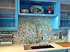 This custom kitchen features a handmade Climbing Vine backsplash shown in Quartz and Aquamarine jewel glass from the Silk Road Collection by New Ravenna.<br /> <br /> For pricing samples and design help, click here: http://www.newravenna.com/showrooms/