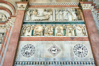 Late medieval relief sculptures  depicting the life of St Martin and the labours of the year on the Facade of the Cattedrale di San Martino,  Duomo of Lucca, Tunscany, Italy,