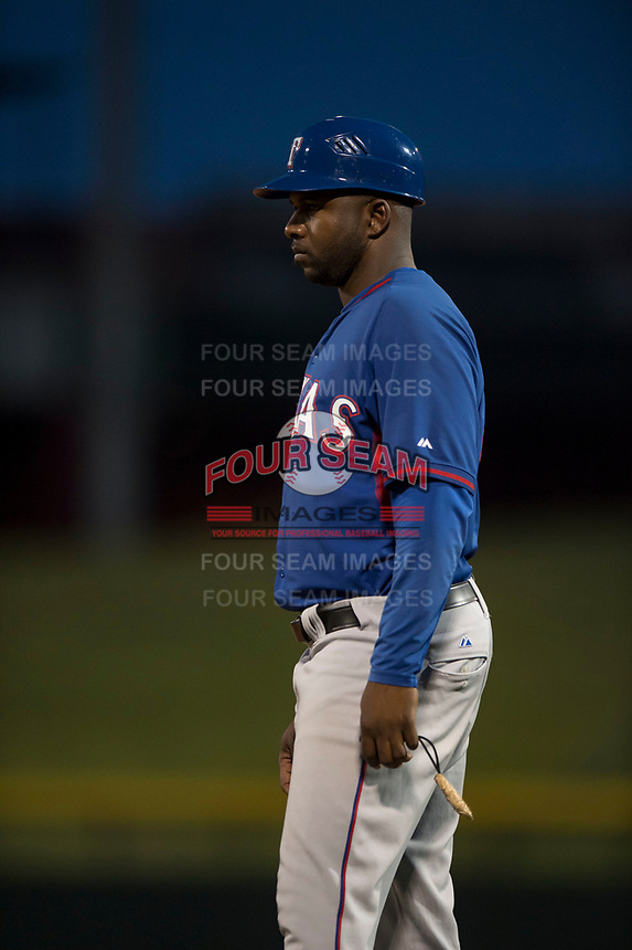 AZL Rangers first base coach Jeremy Moore (43) during an Arizona League game against the AZL Cubs 2 at Sloan Park on July 7, 2018 in Mesa, Arizona. AZL Rangers defeated AZL Cubs 2 11-2. (Zachary Lucy/Four Seam Images)