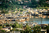 Salvador, Brazil. The shanty town favela of Alagardos with houses on stilts above a polluted river.