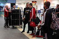 Wednesday 28 August 2013<br /> Pictured: Garry Monk and Lee Trundle checking in at Cardiff Airport.<br /> Re: Swansea City FC players and staff en route for their UEFA Europa League, play off round, 2nd leg, against Petrolul Ploiesti in Romania.