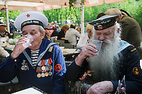 Moscow, Russia, 09/05/2011..Two former sailors drink vodka as Russian World War Two veterans and well-wishers gather in Gorky Park during the country's annual Victory Day celebrations.