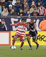 FC Dallas forward/midfielder David Ferreira (10) attempts to shield New England Revolution defender Darrius Barnes (25) from the ball. The New England Revolution defeated FC Dallas, 2-1, at Gillette Stadium on April 4, 2009. Photo by Andrew Katsampes /isiphotos.com