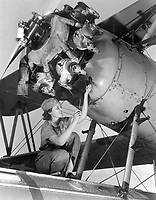 Mary Josephine Farley, who at 20 is considered a top notch mechanic, working on a Wright Whirlwind airplane motor which she rebuilt at Naval Air Base.  Girls like Miss Farley are helping to keep our fighting ships flying.  October 1942.  Howard R. Hollem. (OWI)<br /> Exact Date Shot Unknown<br /> NARA FILE #:  208-AA-352OO-1<br /> WAR & CONFLICT BOOK #:  806