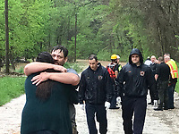 A man a woman are reunited after the man was rescued from the water and the woman was rescued from a flooded home Wednesday near Little Flock. The Bella Vista and Rogers Water Rescue assisted Little Flock with the call.
