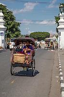 Yogyakarta, Java, Indonesia.  Passengers in Becak, Three-wheeled Rickshaw.