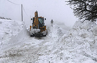 WEATHER PICTURE WALES<br /> Pictured: A bulldozer clears the heavy snow in the village of Trfil, south Wales, UK.<br /> Re: Beast from the East and Storm Emma has been affecting most parts of the UK.