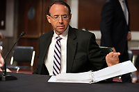 """Former United States Deputy Attorney General Rod Rosenstein prepares to leave after giving testimony at a Senate Judiciary Committee hearing to discuss the FBI's """"Crossfire Hurricane"""" investigation on Wednesday, June 3, 2020.<br /> Credit: Greg Nash / Pool via CNP/AdMedia"""
