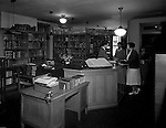 Pittsburgh PA: Students checking-out books at the Duquesne University library.<br /> Brady Stewart was hired to photography the campus, classrooms and offices for a publication to increase enrollment at the Catholic University.