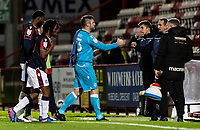 Bolton Wanderers' Matt Gilks bumps fists with an opposition coach as he leaves the pitch<br /> <br /> Photographer Andrew Kearns/CameraSport<br /> <br /> The EFL Sky Bet League Two - Stevenage v Bolton Wanderers - Saturday 21st November 2020 - Lamex Stadium - Stevenage<br /> <br /> World Copyright © 2020 CameraSport. All rights reserved. 43 Linden Ave. Countesthorpe. Leicester. England. LE8 5PG - Tel: +44 (0) 116 277 4147 - admin@camerasport.com - www.camerasport.com