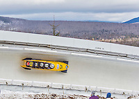 9 January 2016: Germany pilot Francesco Friedrich leads his 4-man team as they cruise through Curve 14 during their second run of the day at the BMW IBSF World Cup Bobsled Championships at the Olympic Sports Track in Lake Placid, New York, USA. Friedrich's team ended the day in 6th place with a 2-run combined time of 1:50.19. Mandatory Credit: Ed Wolfstein Photo *** RAW (NEF) Image File Available ***