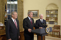 President George W. Bush, center, Secretary of Defense Donald H. Rumsfeld, left, and Secretary of Defense nominee Robert Gates address the nation during a news conference Nov. 8, 2006, from the East Room of the White House. DoD photo by James Bowman, U.S. Air Force. (Released)