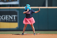 """A member of the """"Molly Maids"""" stops to dance while dragging the infield between innings of the game between the Bowie Baysox and the Richmond Flying Squirrels at The Diamond on July 28, 2021, in Richmond Virginia. (Brian Westerholt/Four Seam Images)"""