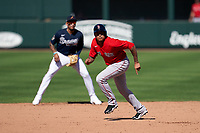 Boston Red Sox Yairo Muñoz (60) running the bases in front of shortstop Johan Camargo (17) during a Major League Spring Training game against the Atlanta Braves on March 7, 2021 at CoolToday Park in North Port, Florida.  (Mike Janes/Four Seam Images)