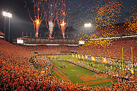 The Clemson Tigers enter the field at night as balloons are released and fireworks explode in the west end zone before their ACC college football game in Clemson. (Travis Bell/SIDELINE CAROLINA)