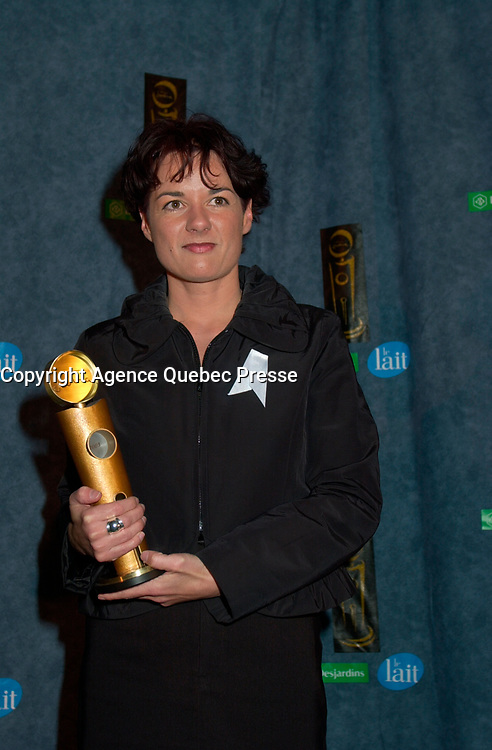 February 23, 2003, Montreal, Quebec, Canada<br /> <br />  Film Maker Manon Briand (R)  poses for  photographerswith Briand's Jutra award (for the film with the most international achievement),February 23, 2003 in Montreal, Quebec, Canada<br /> <br /> <br /> <br /> PHOTO :  Agence Quebec Presse