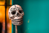 A decorated skeleton figure is seen placed in a window during the Day of the Dead festivities in Oaxaca, Mexico, 31 October 2019. Day of the Dead (Día de Muertos), a religious holiday combining the death veneration rituals of Pre-Hispanic cultures with the Catholic practice, is widely celebrated throughout all of Mexico. Based on the belief that the souls of the departed may come back to this world on that day, people gather together while either praying or joyfully eating, drinking, and playing music, to remember friends or family members who have died and to support their souls on the spiritual journey.