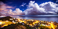 A long-exposure image of Lanikai houses and moonlit clouds from the Pillboxes in Lanikai, O'ahu.