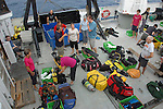 Divers preparing equipment aboard the expedition vessel, Spirit of Enderby.